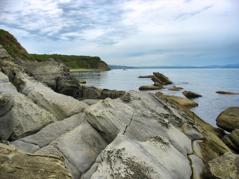 Sea landscape with a rocky shore royalty free stock photo
