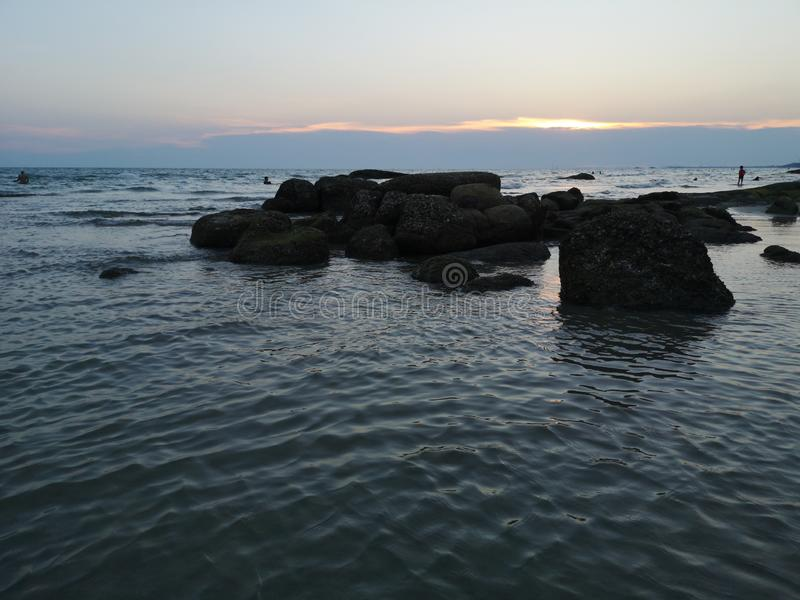 Sea and large rocks During the sunset royalty free stock photos