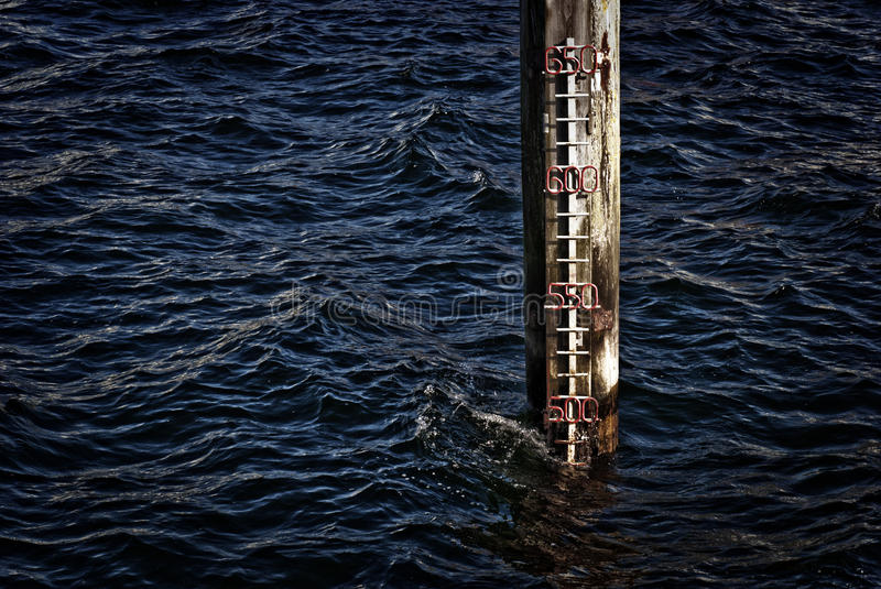 Sea level indicator. In Flensburg harbour, Germany royalty free stock photos