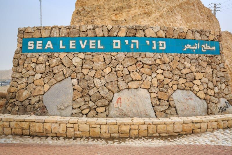 Sea level sign approaching Dead Sea, Israel. Sea level sign written in 3 languages approaching Dead Sea, Israel royalty free stock photo