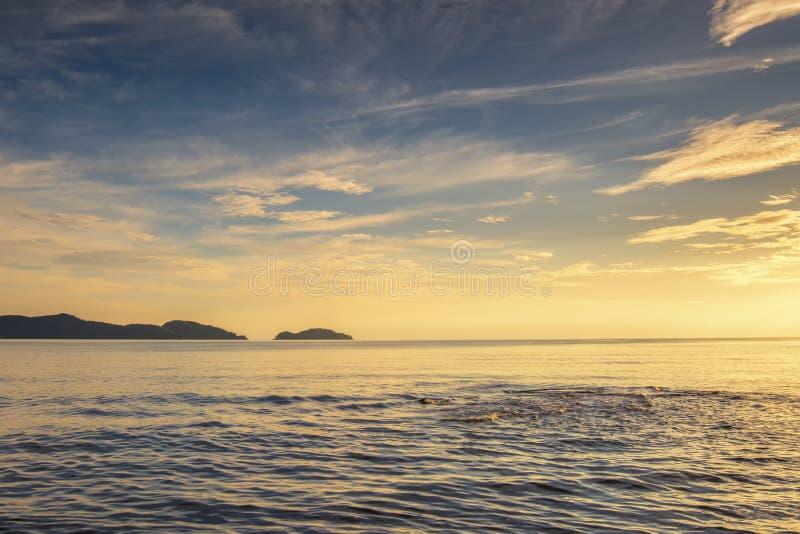 Sea of light Twilight the rock blue sky. Beautiful coastal rocks sea of light Twilight royalty free stock images