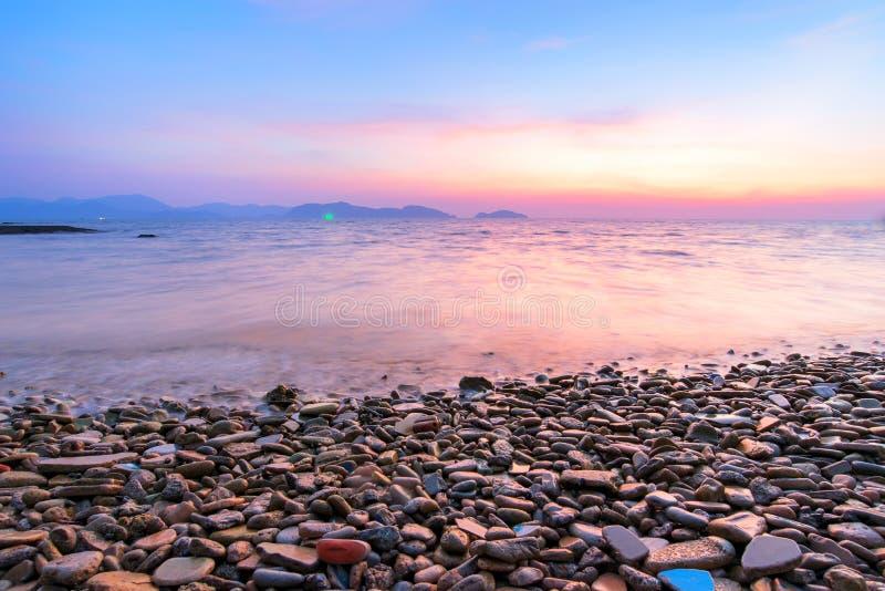 Sea of light Twilight the rock blue sky. Beautiful coastal rocks sea of light Twilight stock photography