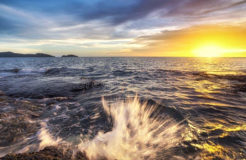 Sea of light Twilight the rock blue sky. Beautiful coastal rocks sea of light Twilight stock image