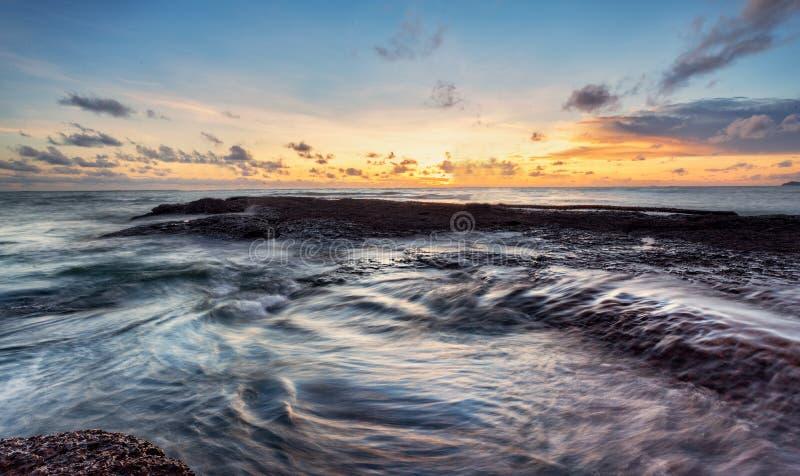 Sea of light Twilight the rock blue sky. Beautiful coastal rocks sea of light Twilight stock photo