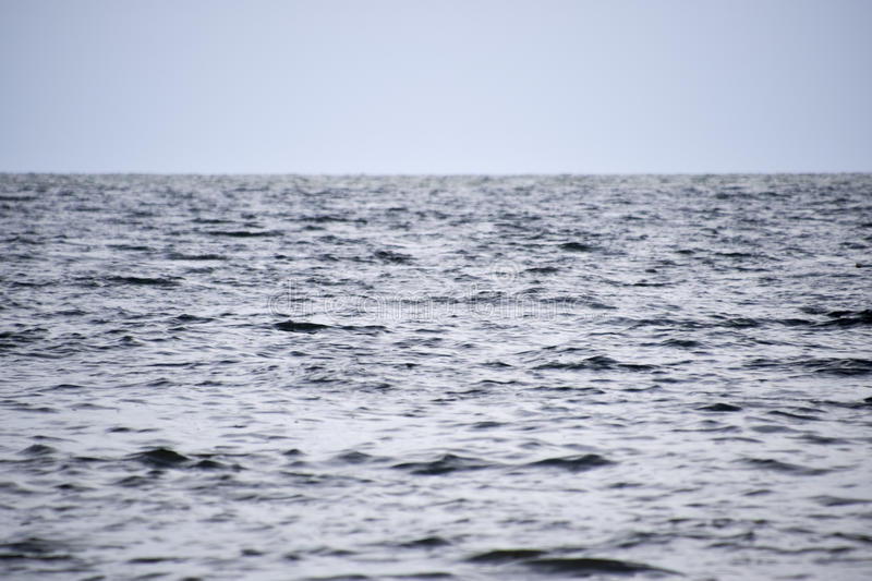 Sea line of the horizon. Sea and sky. The waves and glare of the sun are reflected from the waves of the sea. Seascape. Sea line of the horizon. Sea and sky stock photography