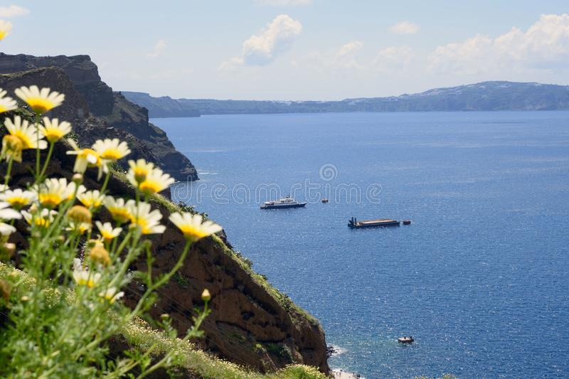 Sea, mountains and rocks. Greek island of Santorini on a warm sunny day. royalty free stock photography