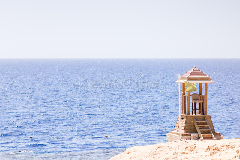 Sea or ocean view from shore with lifeguard post. Safety swimming background with copy space royalty free stock photo