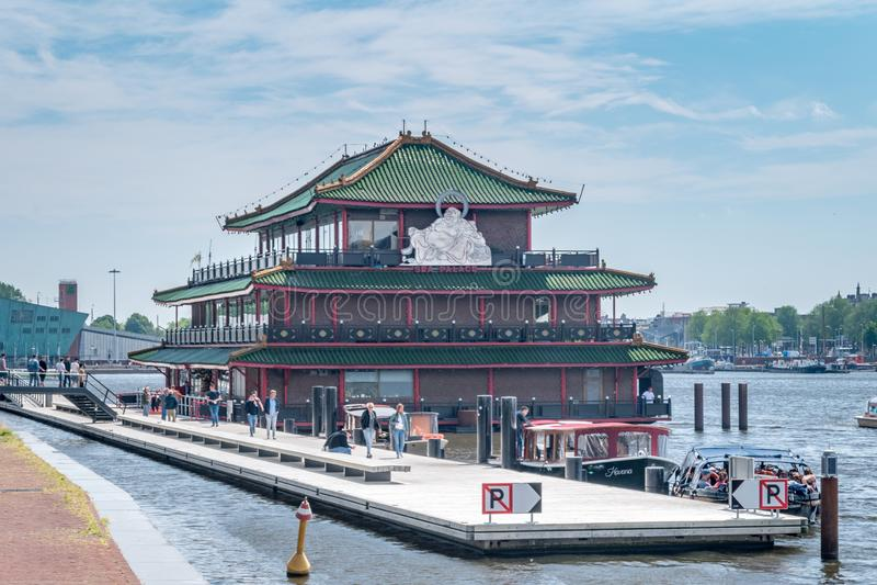 Sea Palace floating restaurant with huge white Buddha statue royalty free stock image