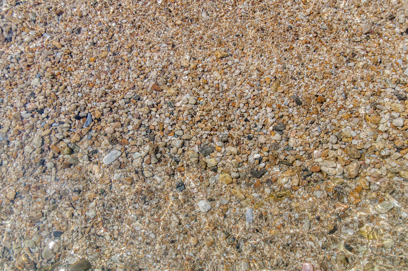 Sea pebble stone and wave background royalty free stock photo
