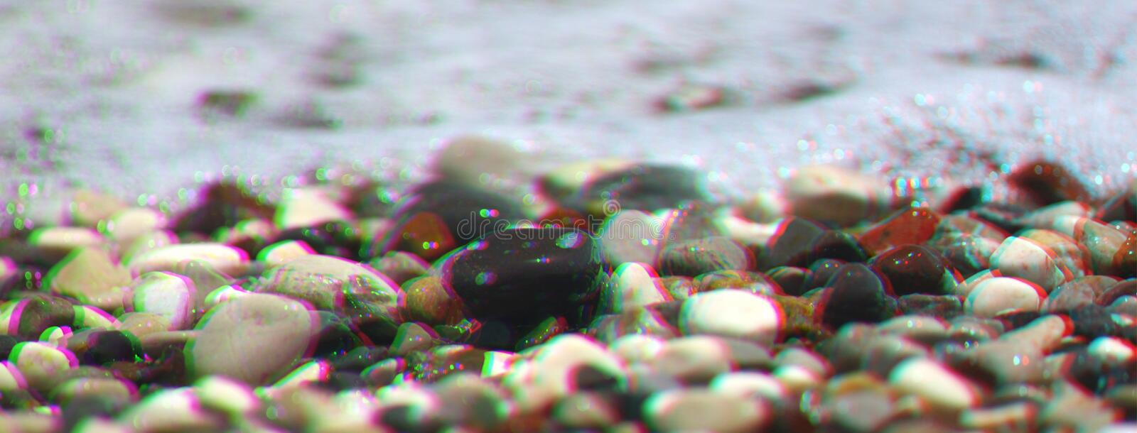 Sea pebbles with foam wave on beach. Anaglyph, glitch shifted effect stock images