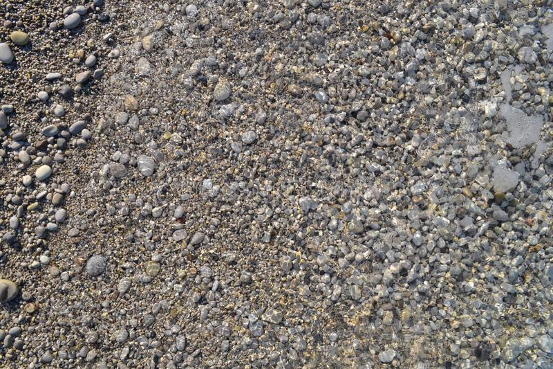 Sea pebbles. Small stones gravel texture background. Pile of pebbles, thailand.Color stone in background royalty free stock photo