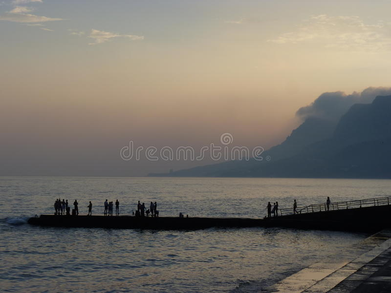 Sea pier at sunset royalty free stock images