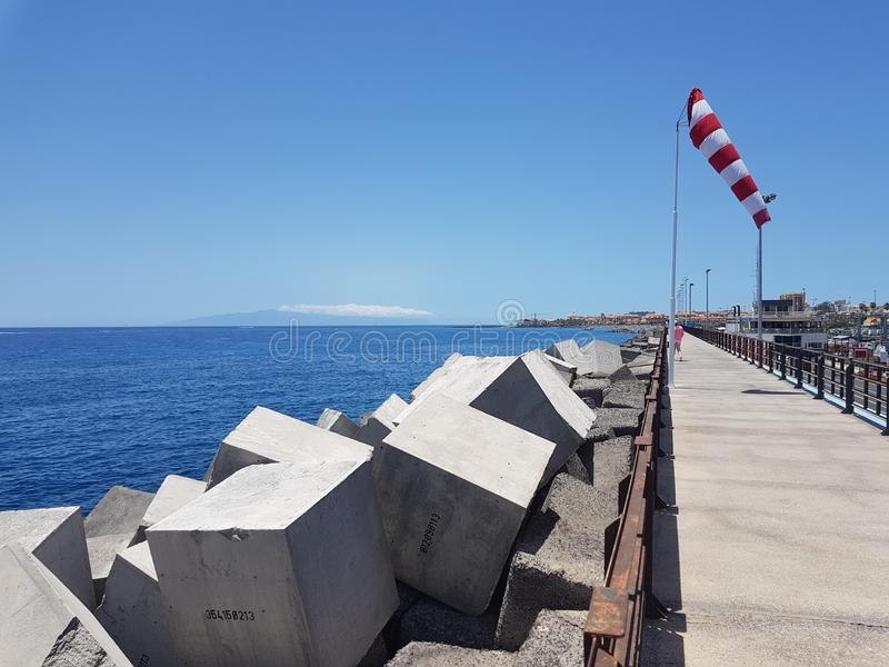 Sea and pier view at Las Cristianos in Tenerife. Sea and pier jetty view with man made concrete cube blocks at Las Cristianos in Tenerife on a beautiful sunny royalty free stock photos