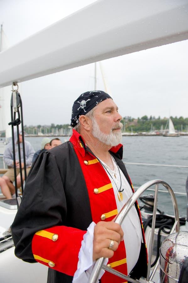 Sea pirate at sailboat helm royalty free stock photo