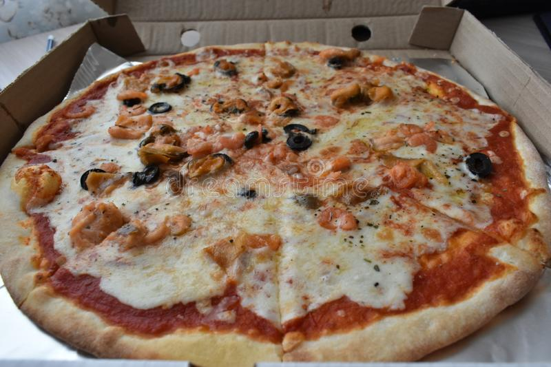 Sea pizza in a box. stock photo
