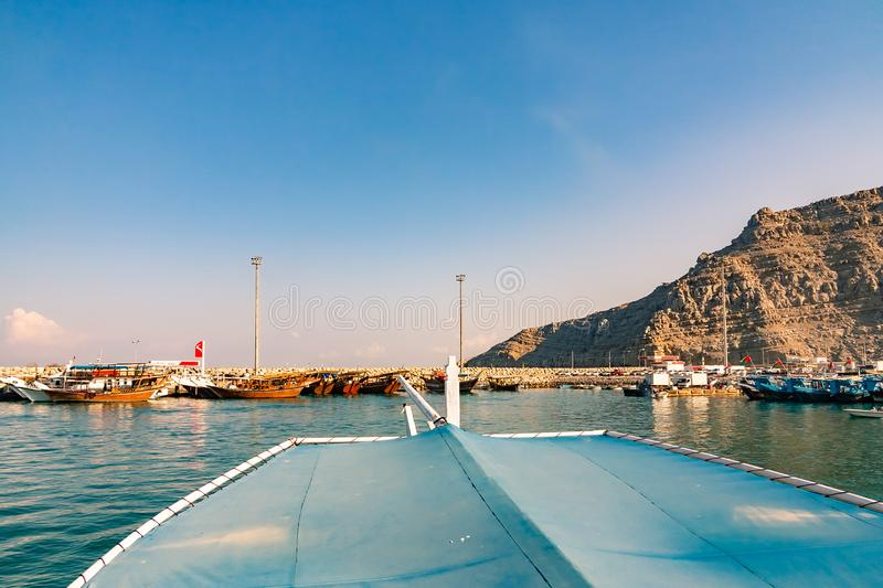 Sea, pleasure boats, rocky shores in the fjords of the Gulf of Oman royalty free stock photography