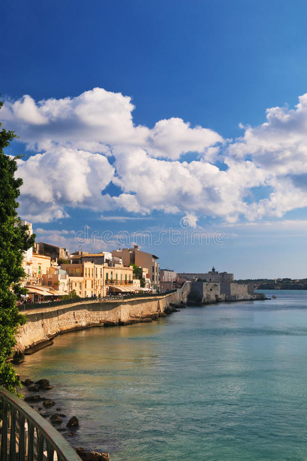Sea promenade in the historical town center of Siracusa. View of the sea promenade in Ortigia, the historical town center of Siracusa which ends with the Maniace royalty free stock images