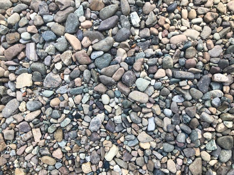 Sea or river stones background, little rocks, small, stones. royalty free stock photo