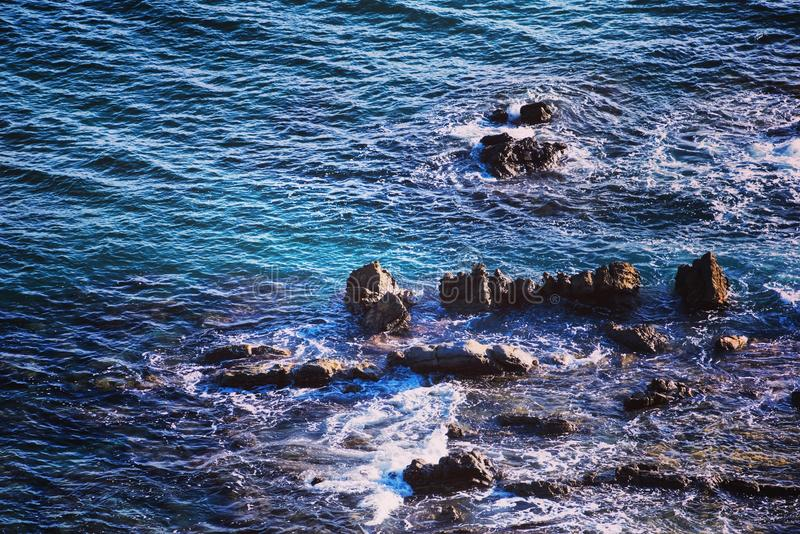 Sea and Rock Formation in Aerial Photo stock photos
