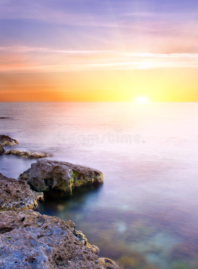 Sea and rock at the sunset. royalty free stock photography