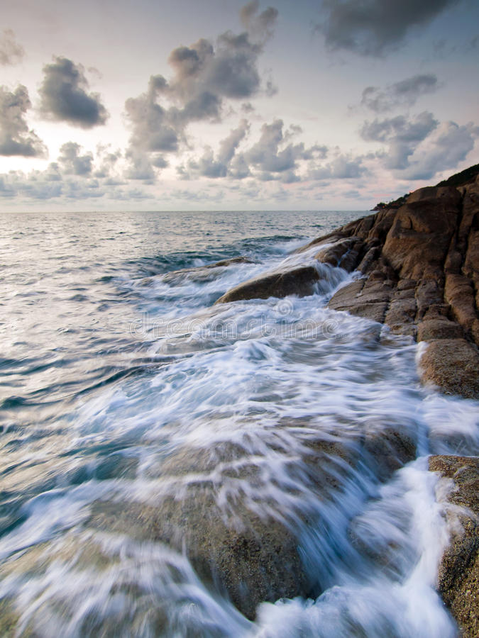 Download Sea and rock at the sunset stock photo. Image of beautiful - 24547690