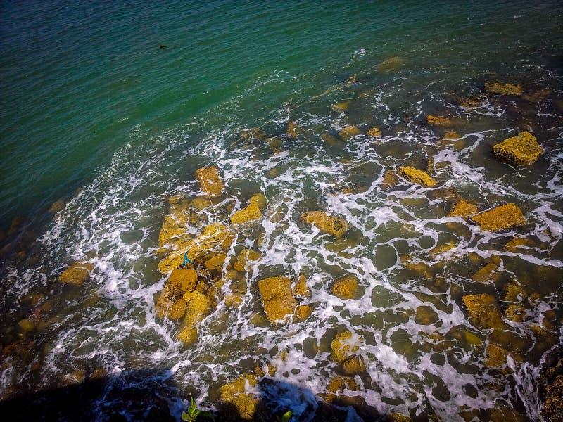 Sea rocks creating foam at sea beach in gujarat india, sea beach in gujarat, gujarat beach, beaches in india. Sea rocks creating foam at sea beach in gujarat stock photos