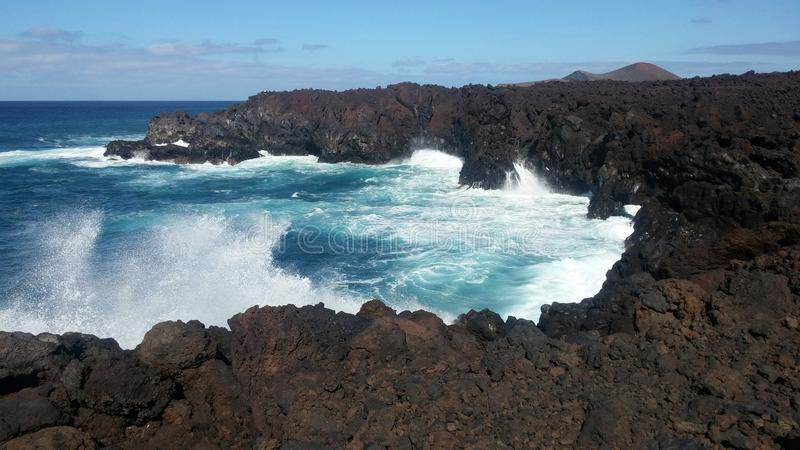 Sea and rocks. The force of the sea models the rocks in Lanzarote stock photo