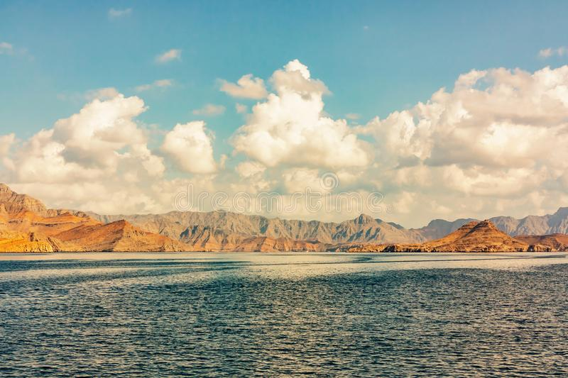 Sea and rocky shores in the fjords of the Gulf of Oman, panoramic view stock photography