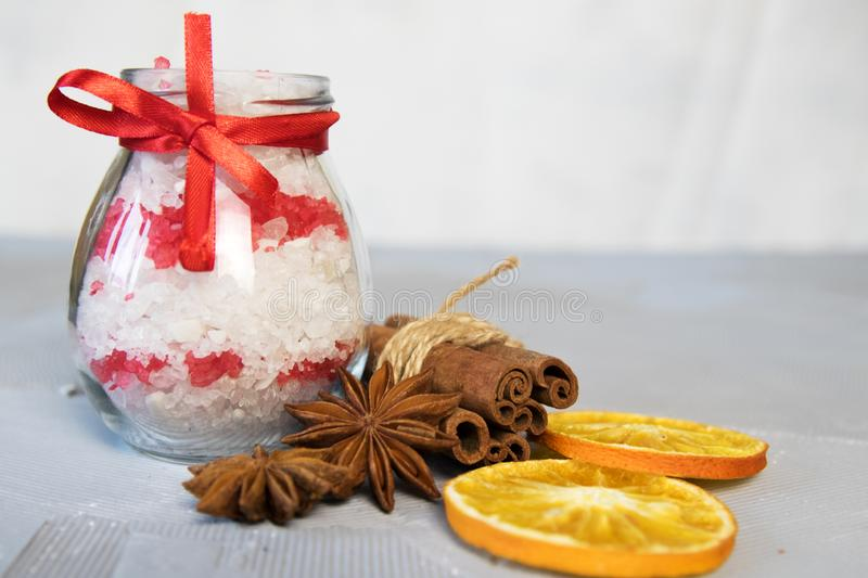 Sea salt for bath with cinnamon, orange and spices royalty free stock photography