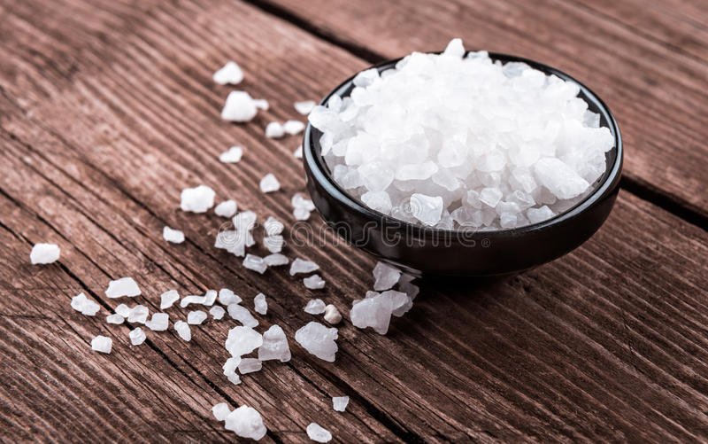 Sea salt in bowl stock images