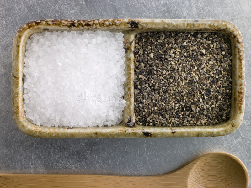 Sea Salt Crystals And Course Cracked Black Pepper Stock Photos