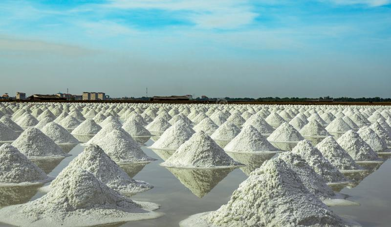 Sea salt farm and barn in Thailand. Organic sea salt. Raw material of salt industrial. Sodium Chloride. Solar evaporation system. Iodine source. Worker working royalty free stock photos