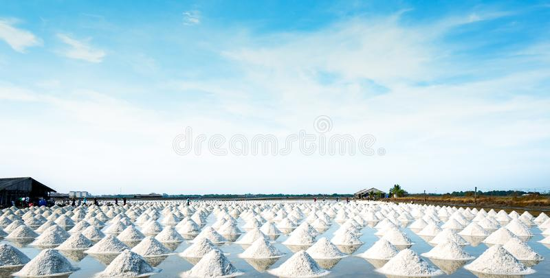 Sea salt farm and barn in Thailand. Raw material of salt industrial. Sodium Chloride. Solar evaporation system. Iodine source. Worker working in farm on sunny stock images