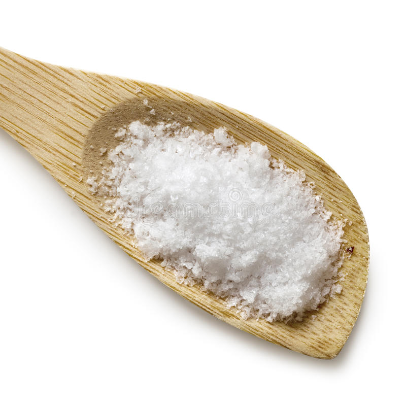 Sea Salt Flakes on Wooden Spoon Isolated royalty free stock images