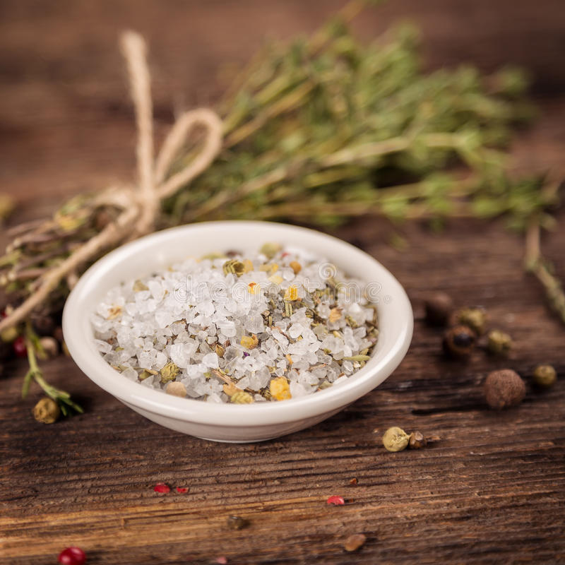 Sea ??salt with herbs royalty free stock photo