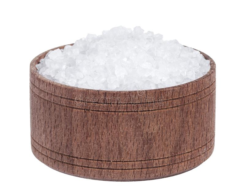 Sea salt in wooden bowl isolated on white background closeup top view royalty free stock images