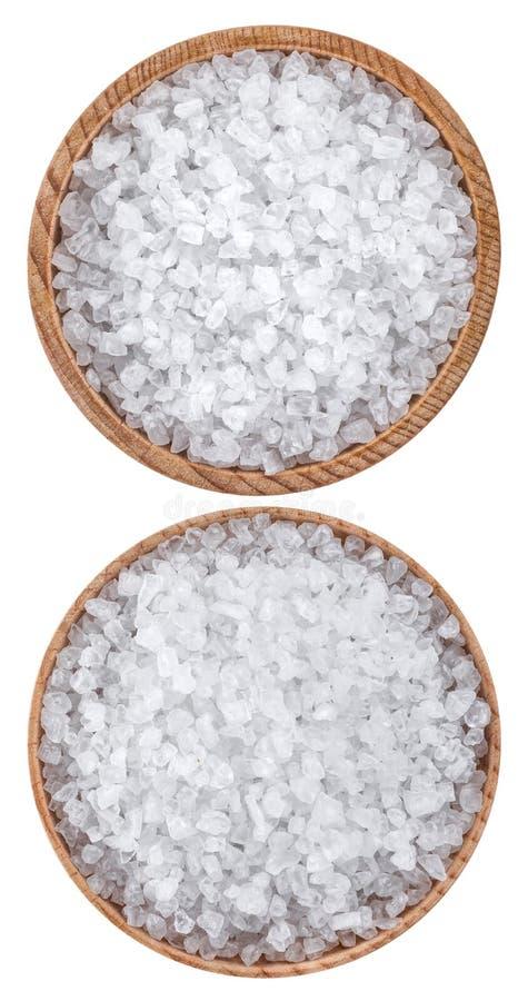 Sea salt in wooden bowl top view stock image