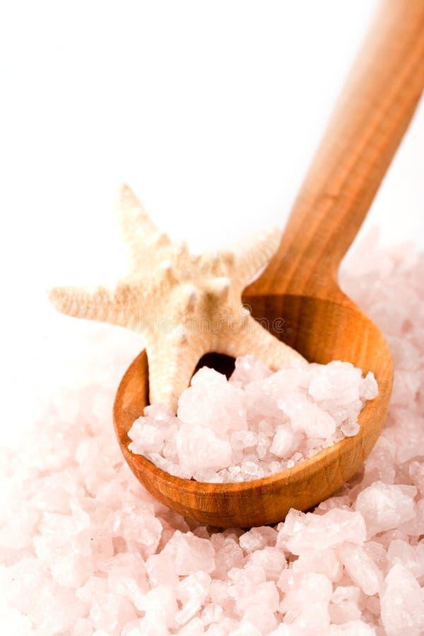 Sea salt on wooden spoon and starfish