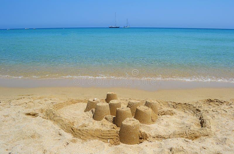 Sea and sand castle stock photo