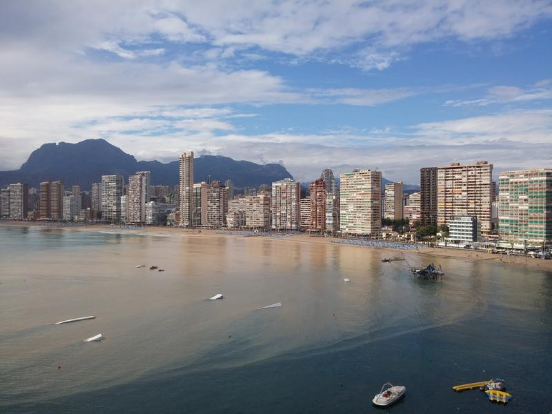 Sea with sand after heavy rain and flood in Benidorm, Spain. Brown sea with sand after heavy rain and flood in Benidorm, Spain royalty free stock photos