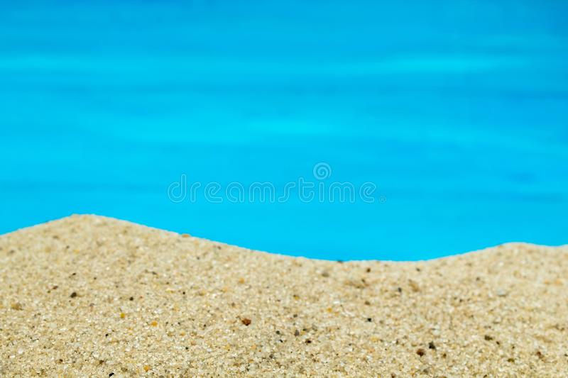 Sea sand and pebbles on blue background. Concept of rest. Top view. royalty free stock photos