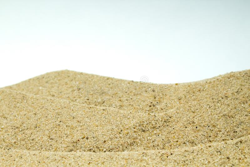 Sea sand and pebbles on white background. Concept of rest. Top view. stock photo