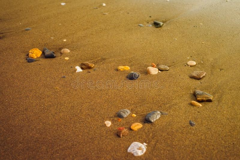 Sea sand and stones shore line waterfront stock image