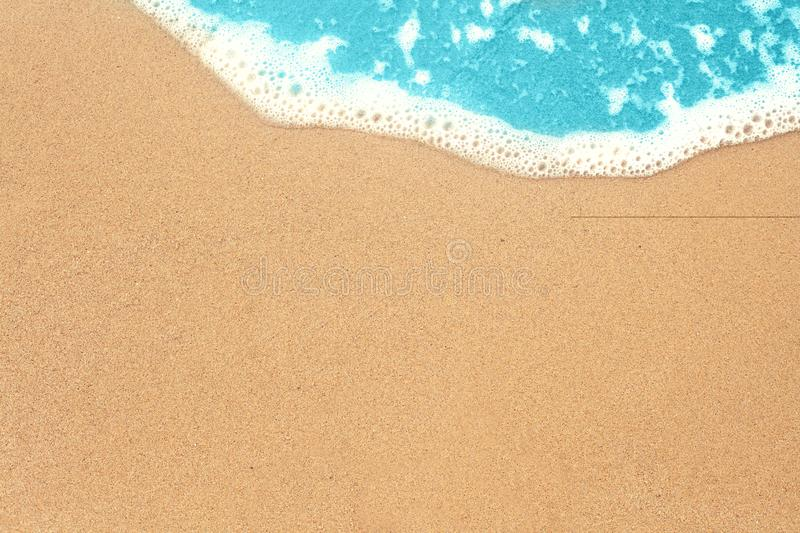 Sea sand and surf texture background. Vacation on ocean beach, summer holiday concept royalty free stock photo