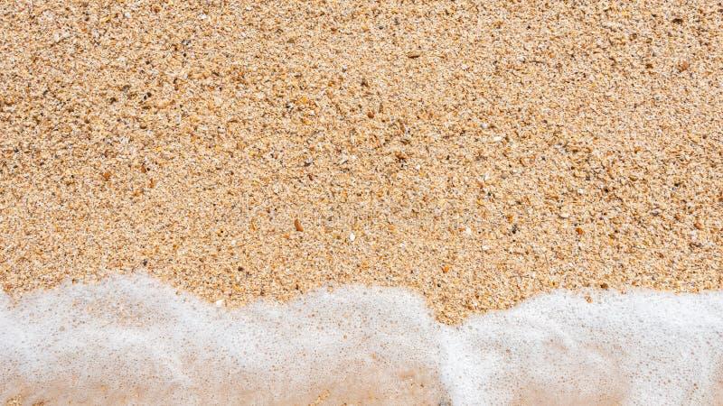 Sea sand with water splash royalty free stock photos