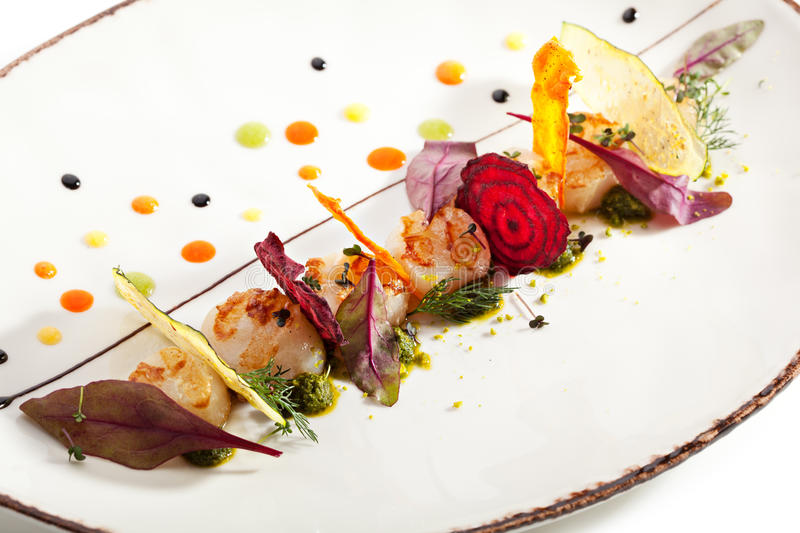 Sea Scallop. With Fried Vegetables Chips royalty free stock image