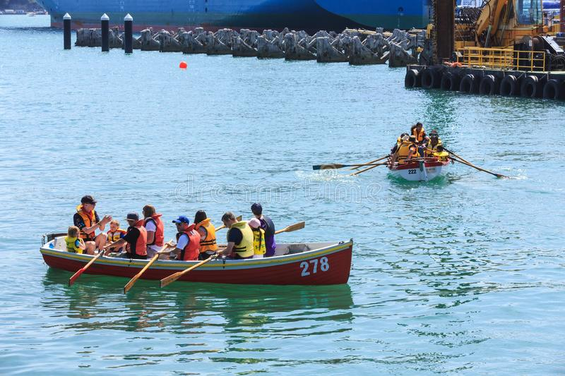 Sea scouts in rowboats on Auckland harbour stock photo