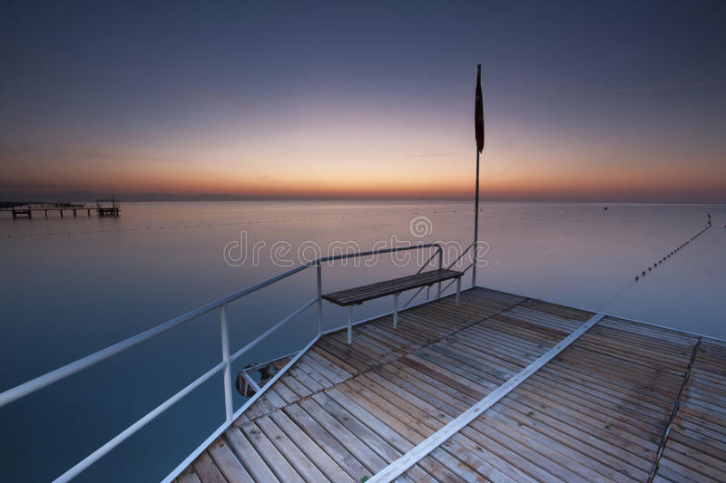 Sea and sea pier and pink and blue sky royalty free stock photography