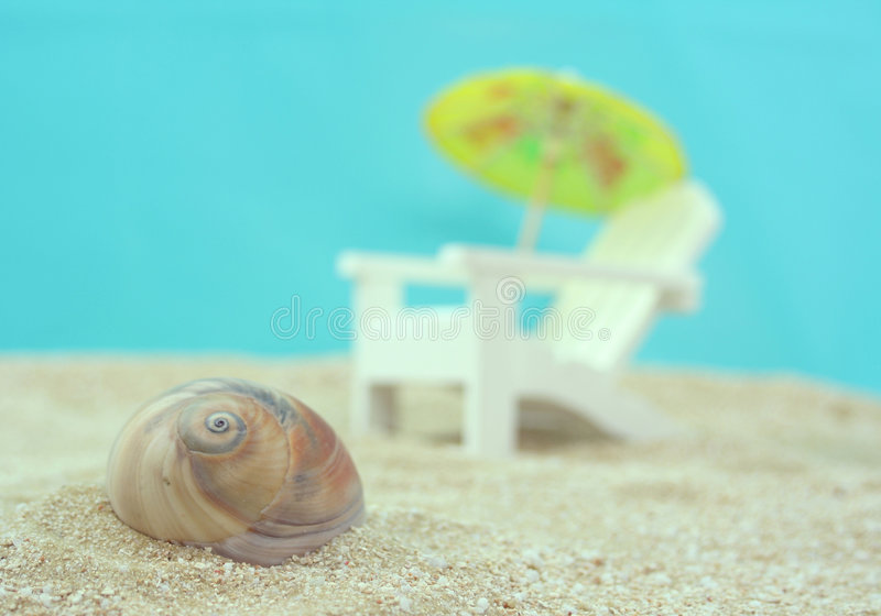 Sea Shell. And Beach Chair with umbrella stock image
