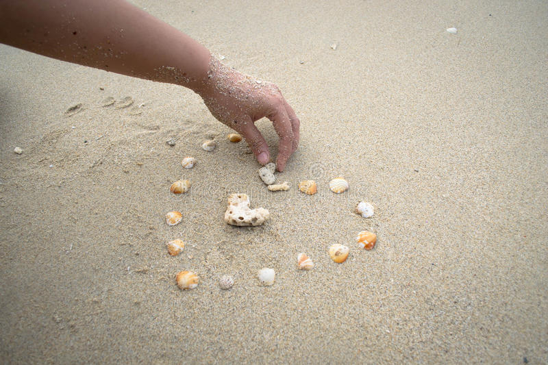 Sea Shell heart on sand background royalty free stock photo
